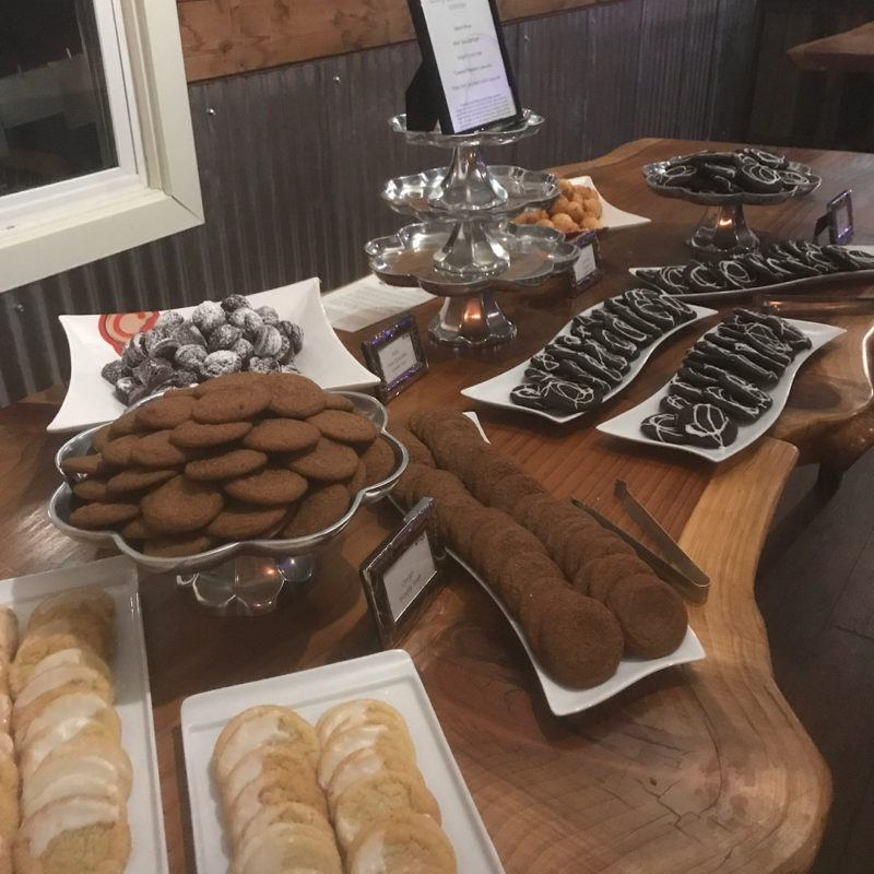 platters of different flavored cookies at wedding dessert bar