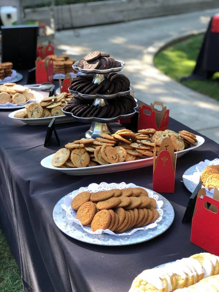 platters of cookies on table with black table cloth