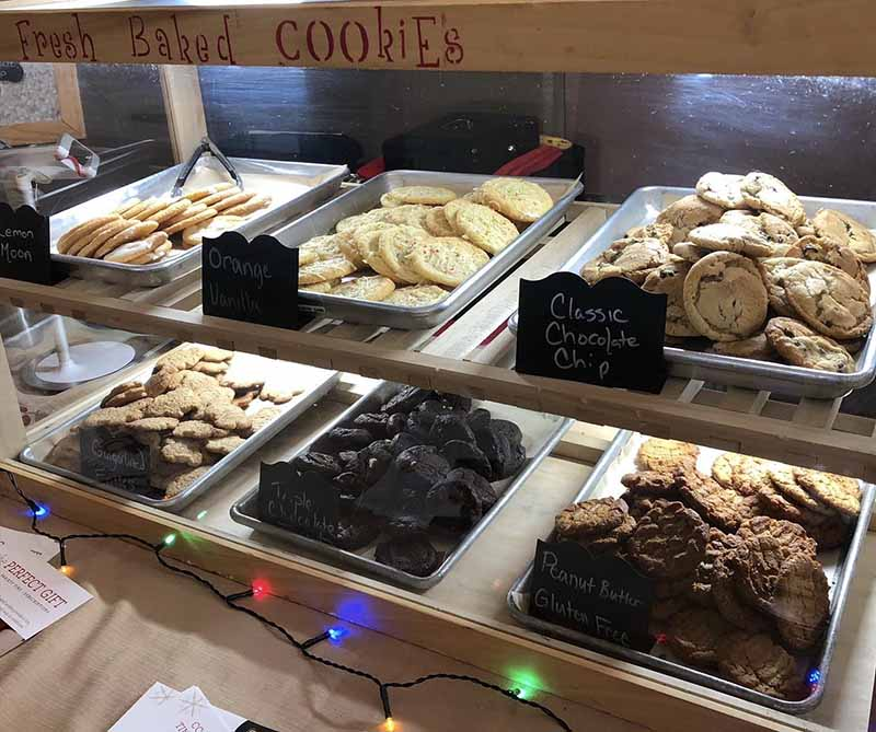 bakery display of festive holiday cookies with christmas lights