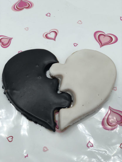 Black and white heart shaped cookies on a decorative valentines day tablecloth