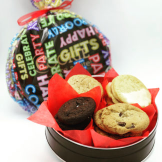cookie tin filled with cookies and wrapped in festive wrapping